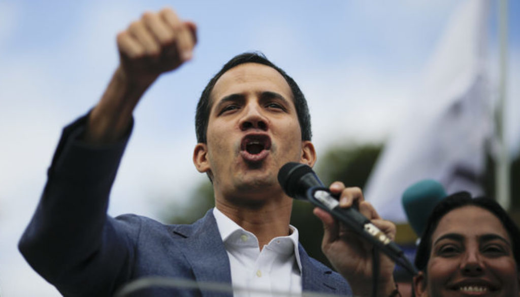 Juan Guaido speaking into microphone.jpg_31344142_ver1.0_640_360.jpg