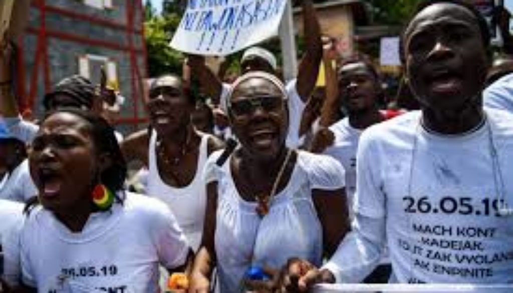 Haitians-march-against-rape-after-students-sexually-assaulted.jpg