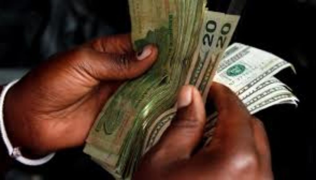 Zimbabwes government is banning the use of foreign currencies when buying goods as it moves towards reintroducing the Zimbabwean dollar