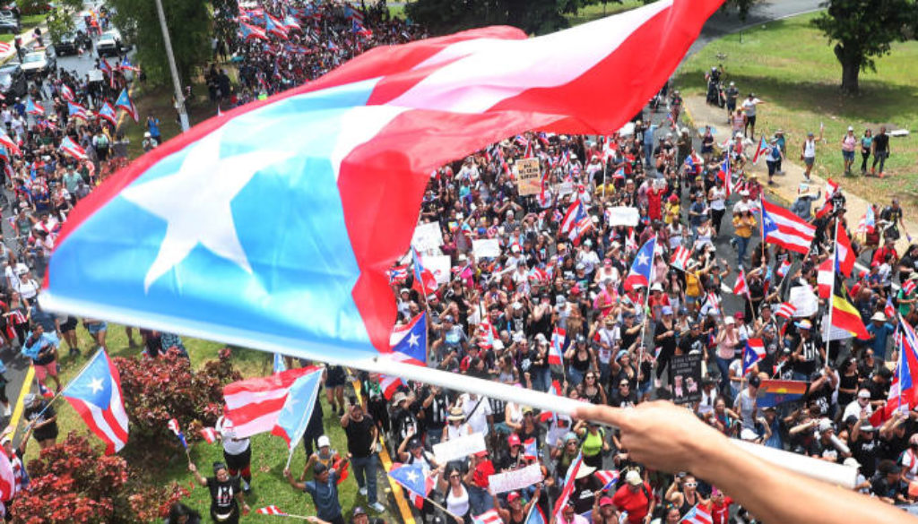 The governor of Puerto Rico will step down in a few days following protests