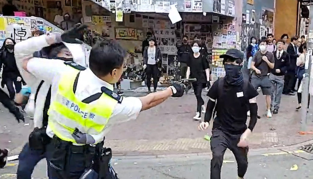 Man-set-alight-hours-after-Hong-Kong-protester-shot-by-police-as-clashes-erupt-citywide.jpg