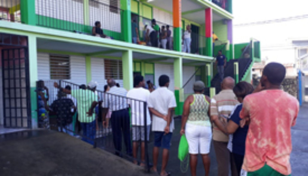 According-to-a-DNO-reporter-some-early-morning-rain-did-not-appear-to-deter-voters-as-long-lines-have-begun-forming-at-some-polling-stations..jpg